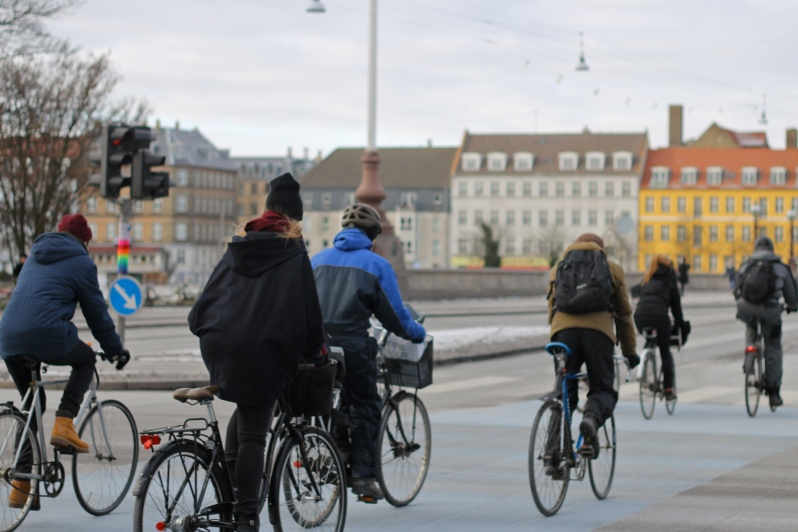 Copenhageners ride bikes in city