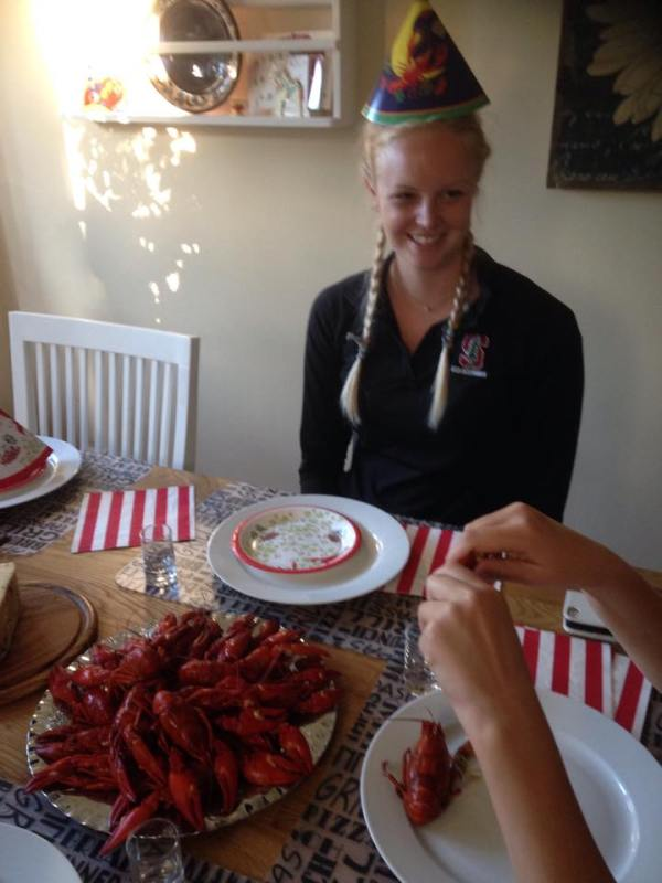 Sitting down to kräftskiva and watching Ida (my host sister) show me how to eat crayfish!